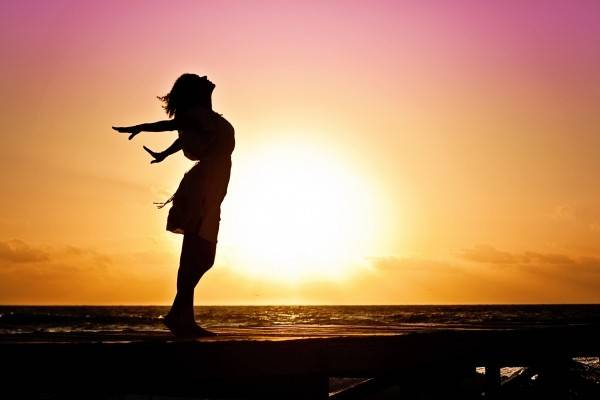 woman-happiness-sunrise-silhouette-dress-beach